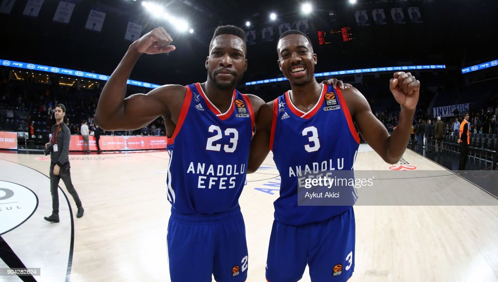 Toney Douglas, #23 of Anadolu Efes Istanbul and Errick McCollum, #3 of Anadolu Efes Istanbul celebrate victory during the 2017/2018 Turkish Airlines EuroLeague Regular Season Round 17 game between Anadolu Efes Istanbul and Crvena Zvezda mts Belgrade at Sinan Erdem Dome on January 12, 2018 in Istanbul, Turkey.