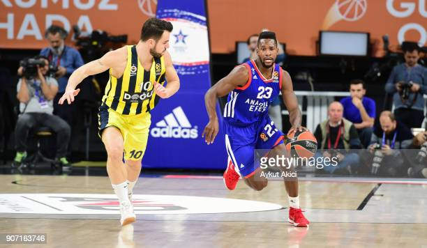 Toney Douglas #23 of Anadolu Efes Istanbul competes with Melih Mahmutoglu #10 of Fenerbahce Dogus Istanbul during the 2017/2018 Turkish Airlines...
