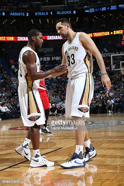 Toney Douglas and teammate Ryan Anderson of the New Orleans Pelicans high five during the game against the Portland Trail Blazers on March 18 2016 at...