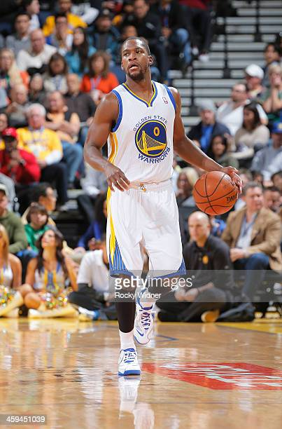 Toney Douglas of the Golden State Warriors dribbles against the Houston Rockets on December 13 2013 at Oracle Arena in Oakland California NOTE TO...