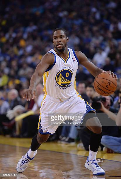 Toney Douglas of the Golden State Warriors dribbles the ball against the Houston Rockets at ORACLE Arena on December 13 2013 in Oakland California...