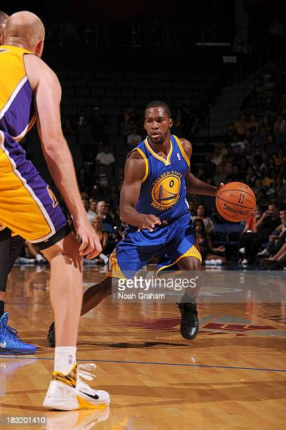 Toney Douglas of the Golden State Warriors drives to the basket against the Los Angeles Lakers at Citizens Business Bank Arena on October 5 2013 in...