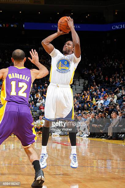 Toney Douglas of the Golden State Warriors shoots against the Los Angeles Lakers on December 21 2013 at Oracle Arena in Oakland California NOTE TO...