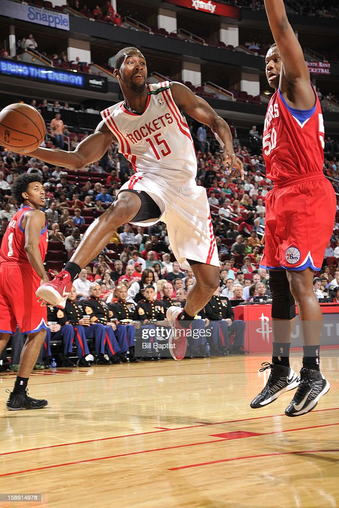 Toney Douglas #15 of the Houston Rockets drives to the basket against the Philadelphia 76ers on December 19, 2012 at the Toyota Center in Houston, Texas.