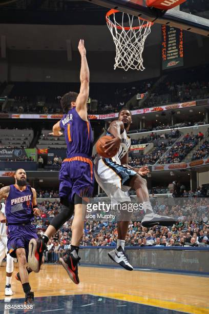 Toney Douglas of the Memphis Grizzlies drives to the basket and passes the ball around Devin Booker of the Phoenix Suns on February 8 2017 at...