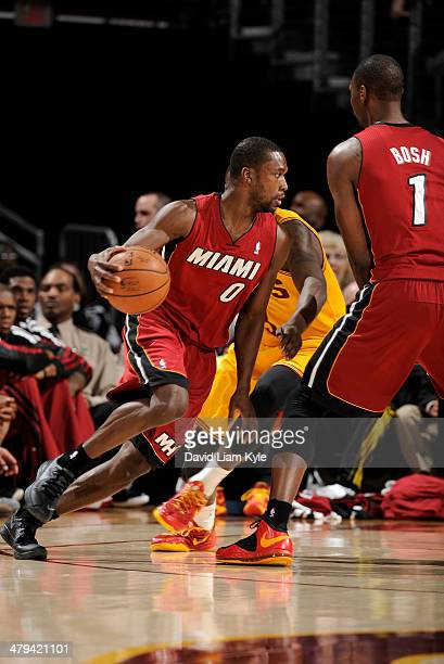 Toney Douglas of the Miami Heat drives against the Cleveland Cavaliers at The Quicken Loans Arena on March 18 2014 in Cleveland Ohio NOTE TO USER...