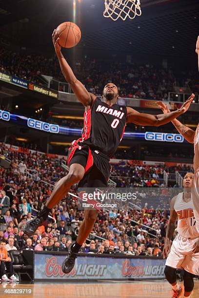 Toney Douglas of the Miami Heat drives for a shot against the Phoenix Suns on February 11 2014 at US Airways Center in Phoenix Arizona NOTE TO USER...