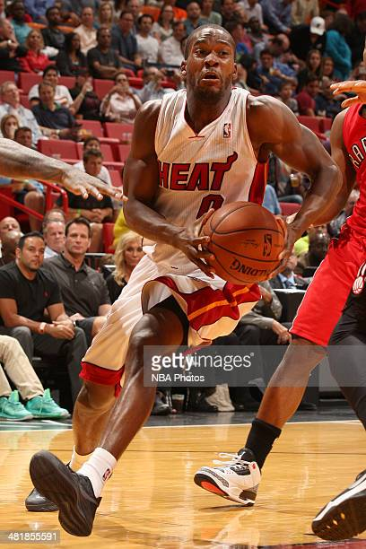 Toney Douglas of the Miami Heat handles the ball against the Toronto Raptors at the American Airlines Arena in Miami Florida on March 31 2014 NOTE TO...