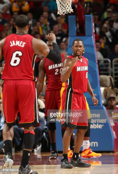 Toney Douglas of the Miami Heat pumps his fist during the game against the Cleveland Cavaliers at The Quicken Loans Arena on March 18 2014 in...