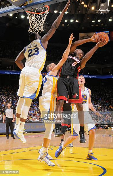Toney Douglas of the Miami Heat shoots against the Golden State Warriors on February 12 2014 at Oracle Arena in Oakland California NOTE TO USER User...