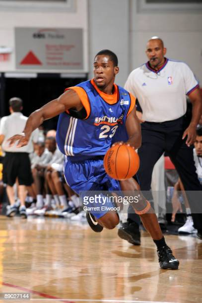 Toney Douglas of the New York Knicks dribbles against the Memphis Grizzlies during NBA Summer League presented by EA Sports at Cox Pavilion July 14...