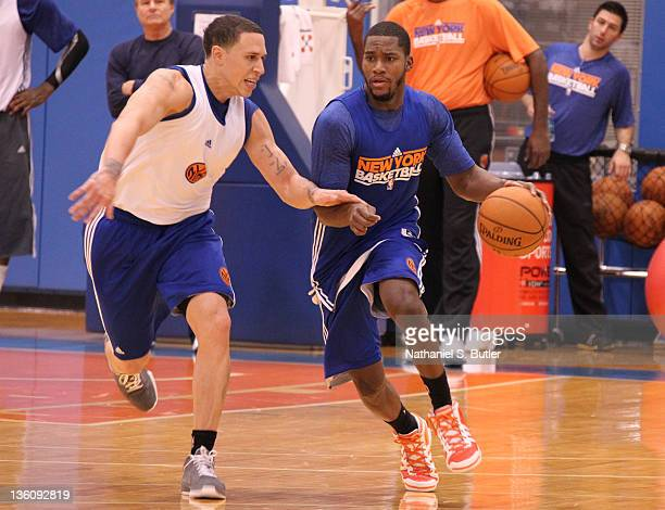 Toney Douglas of the New York Knicks drives against teammate Mike Bibby during practice on December 19 2011 at the Madison Square Garden Training...