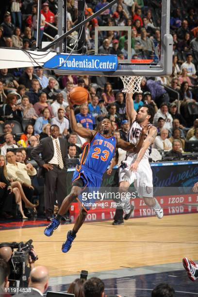 Toney Douglas of the New York Knicks shoots against Jordan Farmar of the New Jersey Nets on April 8 2011 at Prudential Center in Newark New Jersey...
