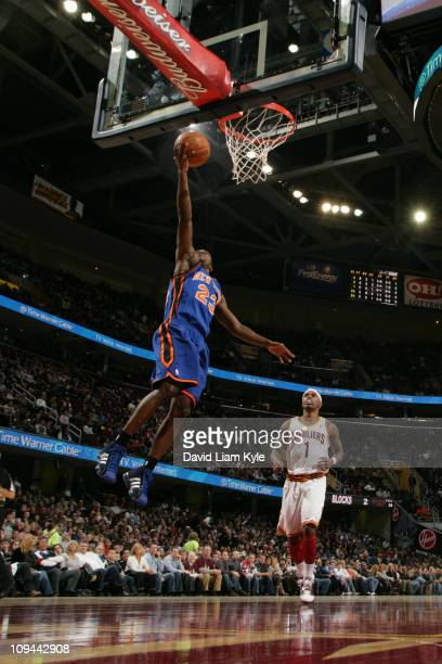 Toney Douglas of the New York Knicks shoots against the Cleveland Cavaliers at The Quicken Loans Arena on February 25 2011 in Cleveland Ohio NOTE TO...