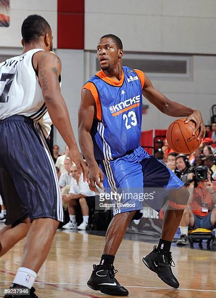 Toney Douglas of the New York Knicks surveys the court against Andre Owens of the Detroit Pistons during NBA Summer League presented by EA Sports on...