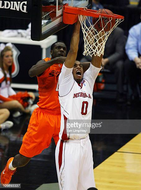 Toney McCray of the Nebraska Cornhuskers dunks the ball in a game against the Oklahoma State Cowboys during the first round of the 2011 Phillips 66...