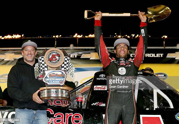 Toney Stewart presents Darrell Wallace Jr driver of the ToyotaCare Toyota with a trophy after winning the Camping World Truck 2nd Annual 1800 Car...