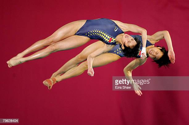 Tong Jia and Ruolin Chen of China compete in the Women's 10m Synchronised Platform preliminary event during the XII FINA World Championships on March...