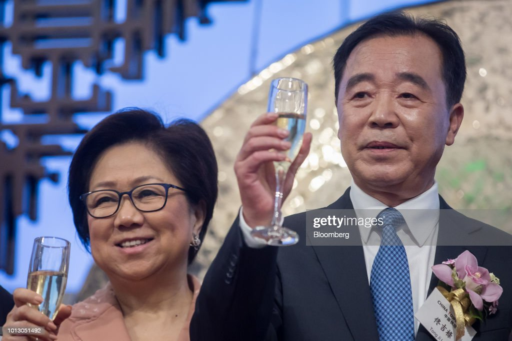 Tong Jilu, chairman of China Tower Corp., right, and Laura Cha, chairman of Hong Kong Exchanges & Clearing Ltd., raise their glasses for a toast during the company's listing ceremony at the Hong Kong Stock Exchange in Hong Kong, China, on Wednesday, Aug. 8, 2018. China Tower inched up in Hong Kong trading debut after completing the world's largest initial public offering in two years. Photographer: Paul Yeung/Bloomberg via Getty Images