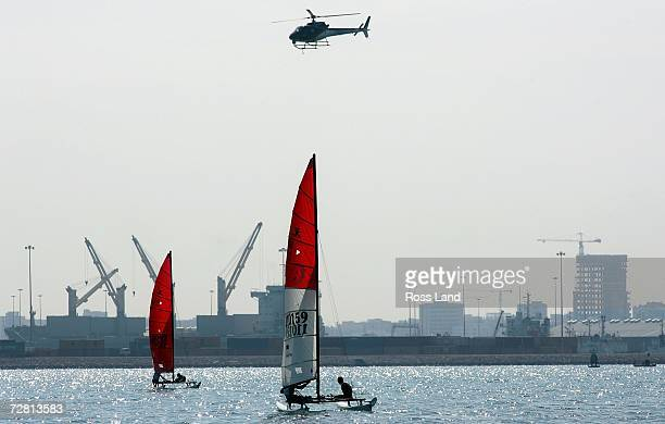 Tong Yui Shing and Lo Kin Yee of Hong Kong and Huang Jingjie Melcolm and Chung Pei Quan of Singapore compete in the Hobie 16 Open Race at the 15th...
