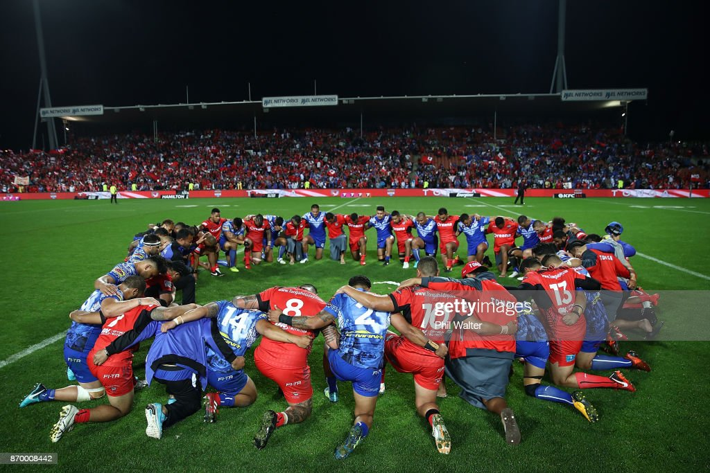 Tonga and Samoa pray following the 2017 Rugby League World Cup match between Samoa and Tonga at Waikato Stadium on November 4, 2017 in Hamilton, New Zealand.