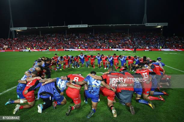 Tonga and Samoa pray following the 2017 Rugby League World Cup match between Samoa and Tonga at Waikato Stadium on November 4 2017 in Hamilton New...