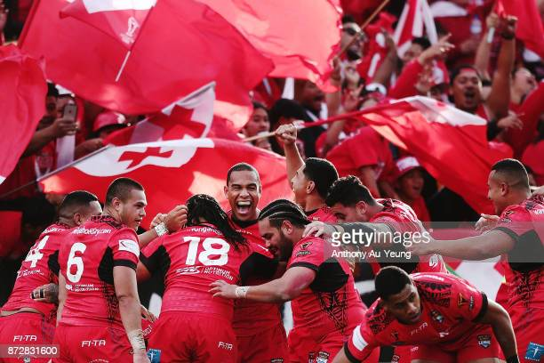 Tonga celebrate a try during the 2017 Rugby League World Cup match between the New Zealand Kiwis and Tonga at Waikato Stadium on November 11 2017 in...