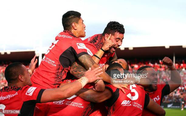 Tonga celebrate during the 2017 Rugby League World Cup match between the New Zealand Kiwis and Tonga at Waikato Stadium on November 11 2017 in...