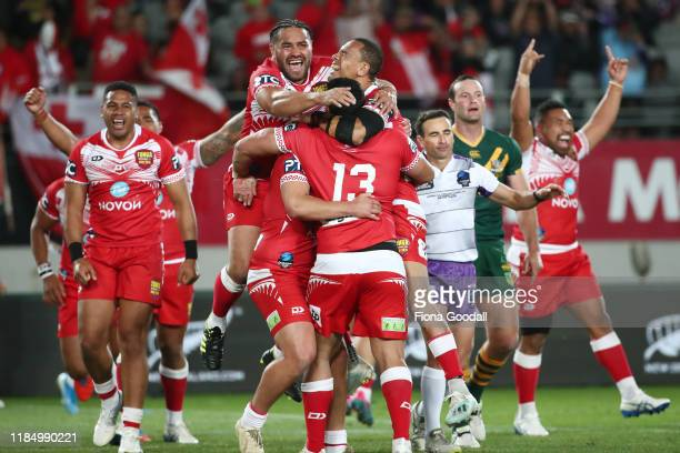 Tonga celebrate their win over Australia during the Rugby League International Test match between the Australia Kangaroos and Tonga at Eden Park on...