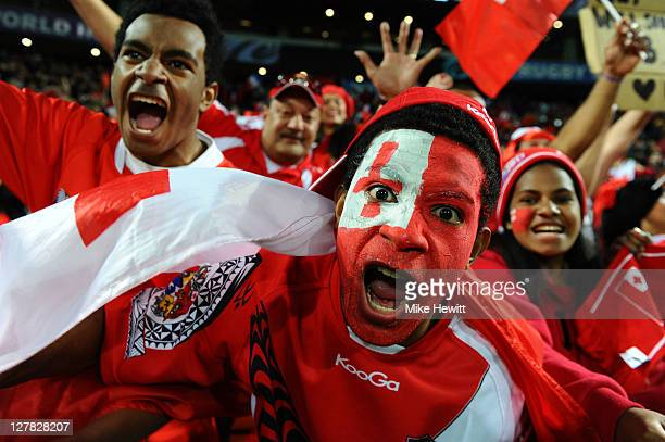 Tonga fans celebrate their team's 1419 victory during the IRB 2011 Rugby World Cup Pool A match between France and Tonga at Wellington Regional...