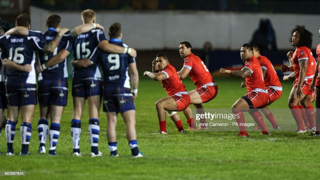 Tonga perform a hakka before the 2013 World Cup match at Derwent Park, Workington.