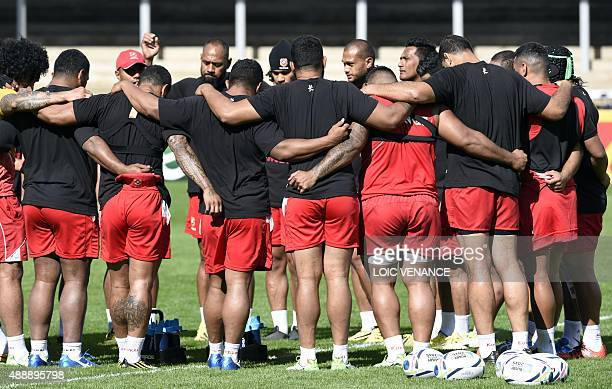 Tonga players come together for a team huddle during a training session on September 18 2015 at the Kingsholm stadium in Gloucester during the 2015...