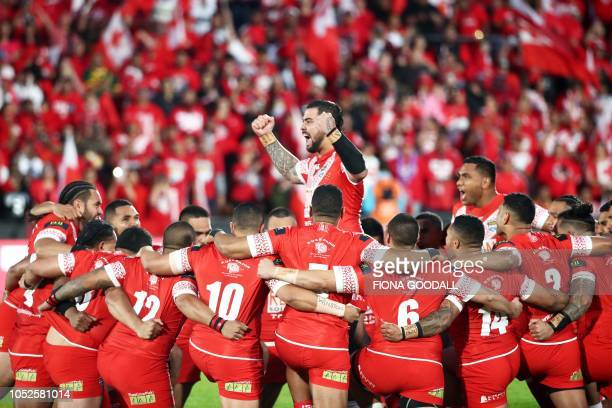 Tonga players perform the Sipi Tau or Tongan war cry during the rugby league international Test match between Australia and Tonga at Mt Smart Stadium...