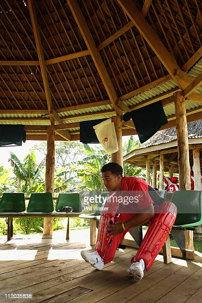 Tongan cricket player pads up before batting during the ICC East Asia Pacific Division 2 tournament held at the Garden Ovals on April 07, 2011 in...