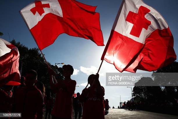 Tongan fans bear flags as they arrive ahead of the rugby league international Test match between Australia and Tonga at Mt Smart Stadium in Auckland...
