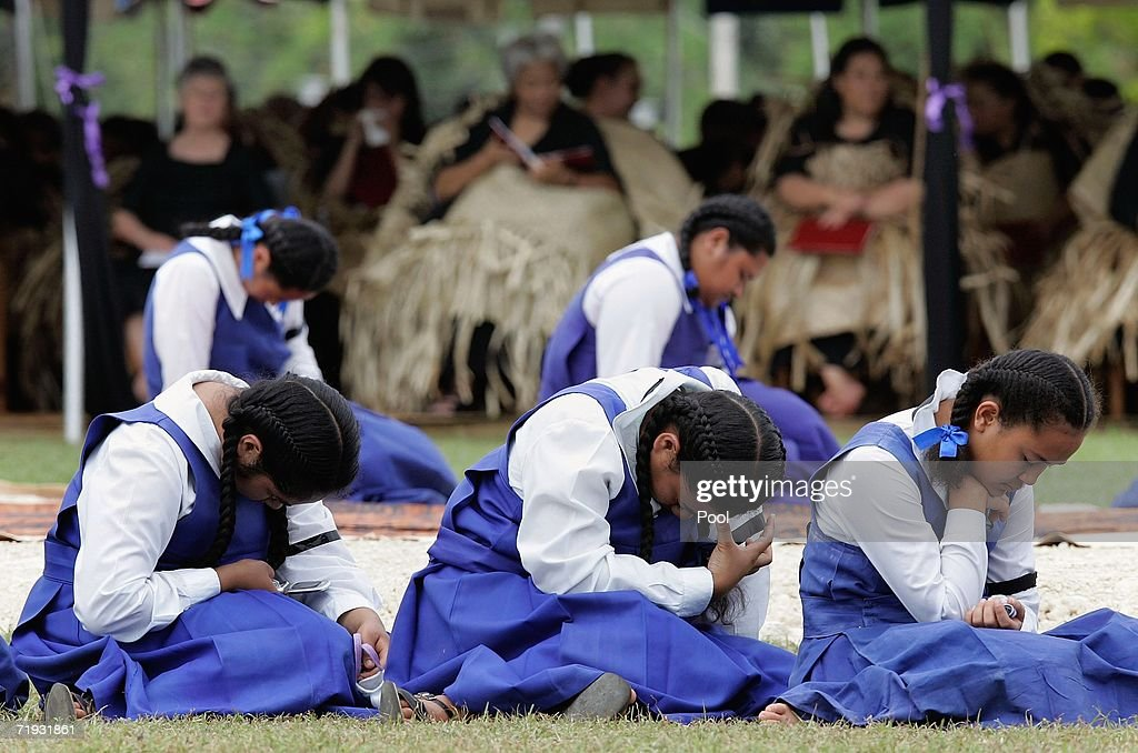 Tongan girls bow their heads during the state funeral of the late King Taufa'ahau Tupou IV of Tonga on September 19, 2006 in Nuku'alofa, Tonga. King Taufa'ahau Tupou IV died on September 10, 2006 after a long illness. He was 88 and had been ruler of Tonga since the death of his mother in 1965. Crown Prince Tupouto'a has taken over the king's duties.