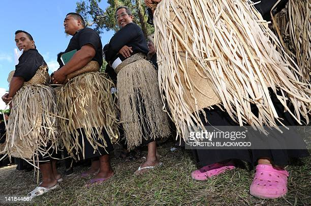 Tongan men dressed in black and wearing the traditional ta'ovala waistmats gather to pay their respects to Queen Halaevala Mata'aho the mother of...