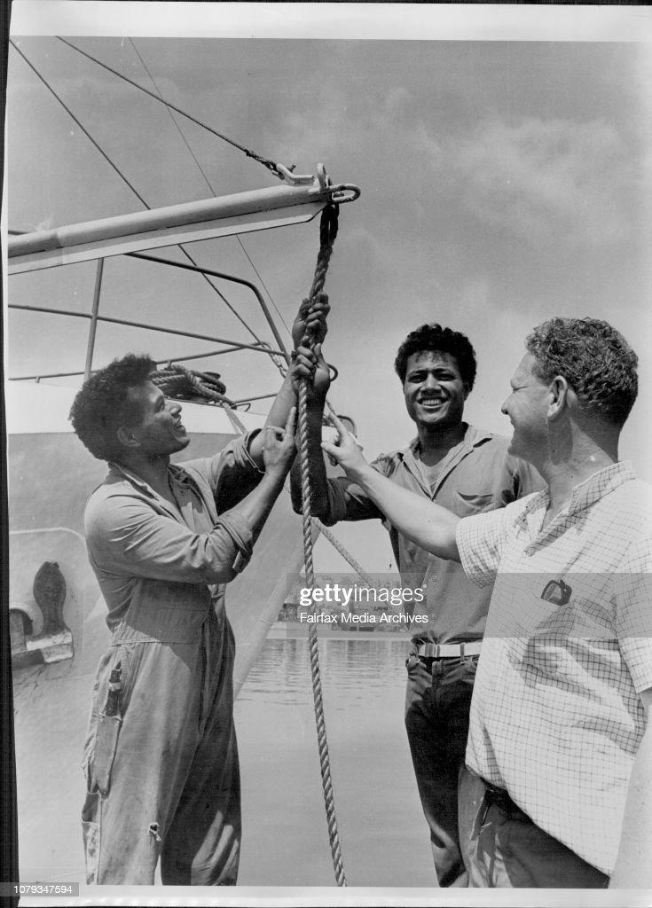 Tongan seaman aboard the fishing trawler Ata.Skipper Peter Warner with (left to right) Stephen, John and Peter Warner. : News Photo