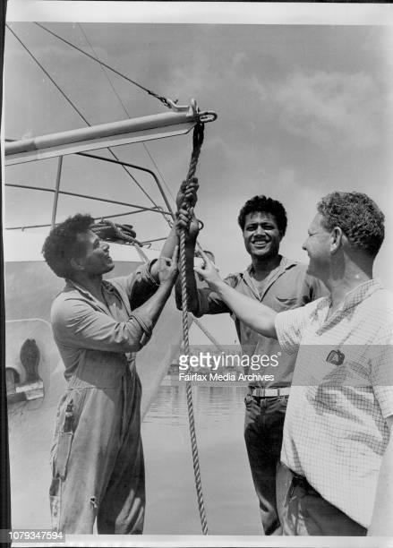 Tongan seaman aboard the fishing trawler Ata.Skipper Peter Warner with Stephen, John and Peter Warner. March 01, 1968. .