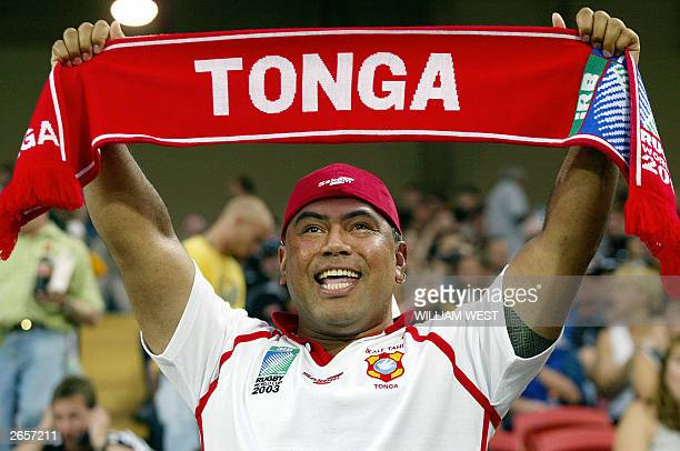 Tongan supporter waves a scarf as his team plays theor match against the New Zealand All Blacks at Suncorp Stadium in Brisbane 24 October 2003 The...
