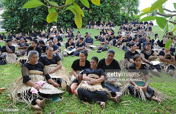 Tongan women dressed in black and wearing the traditional ta'ovala waistmats gather to pay their respects to Queen Halaevala Mata'aho the mother of...