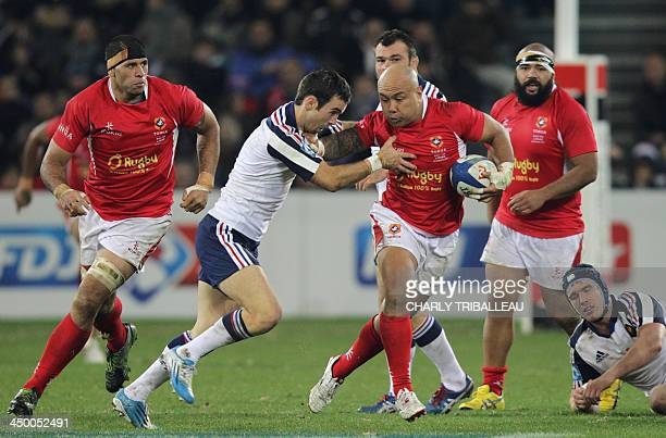 Tonga's flanker Nili Latu fights for the ball with Frances scrum half Morgan Parra during the rugby union test match between France and Tonga at the...