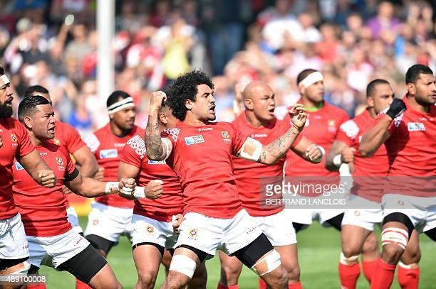 Tonga's flyhalf Latiume Fosita and teammates perform their war dance before a Pool C match of the 2015 Rugby World Cup between Tonga and Georgia at...