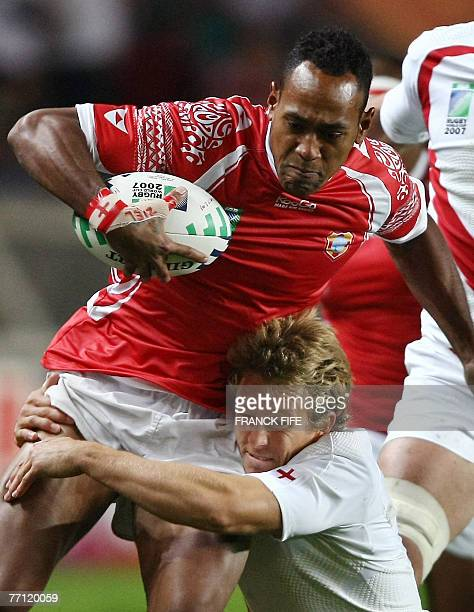 Tonga's fullback Vunga Lilo is tackled by England's flyhalf Jonny Wilkinson during the rugby union World Cup group A match England vs Tonga 28...