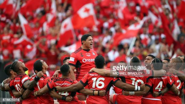 Tonga's Jason Taumalolo leads the challenge to England before the Rugby League World Cup men's semifinal match between Tonga and England at Mt Smart...