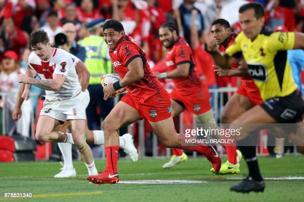 Tonga's Jason Taumalolo makes a break during the Rugby League World Cup men's semifinal match between Tonga and England at Mt Smart Stadium in...