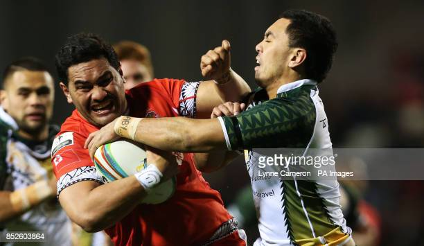Tonga's Konrad Hurrell and Cook Island's Brad Takairangi during the the 2013 World Cup match at Leigh Sports Village Leigh