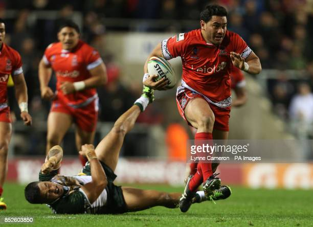 Tonga's Konrad Hurrell and Cook Island's Jordan Rapana during the the 2013 World Cup match at Leigh Sports Village Leigh
