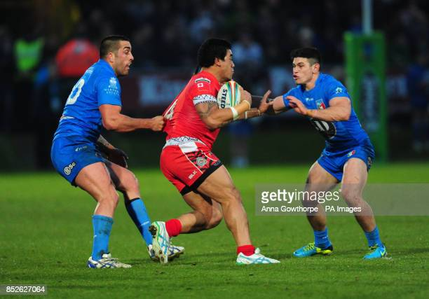 Tonga's Mahe Fonua is tackled by Italy's Paul Vaughan and Dean Parata during the 2013 World Cup match at The Shay Halifax