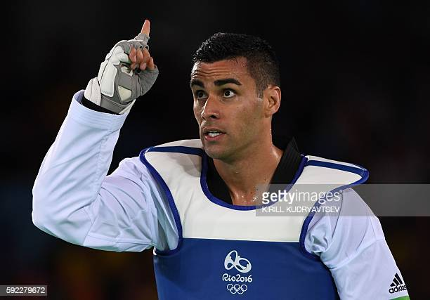Tonga's Pita Nikolas Taufatofua gestures after his men's taekwondo qualifying bout in the 80kg category as part of the Rio 2016 Olympic Games on...